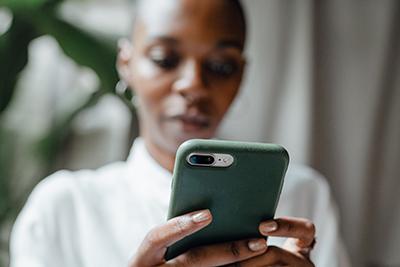 Woman holding phone reminder